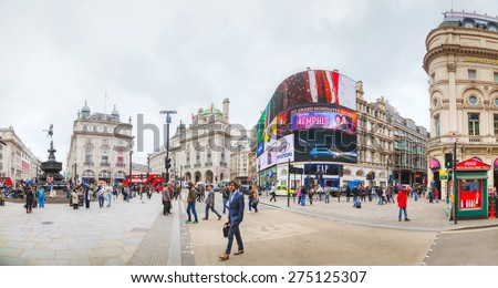 LONDON - APRIL 13: Piccadilly Circus junction crowded by people on April 13, 2015 in London, UK. It's a road junction and public space of London's West End in the City of Westminster, built in 1819. - stock photo