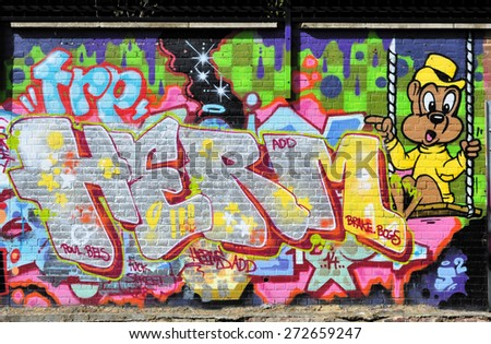 LONDON - APRIL 11, 2015. Street art near Pedley Street, Shoreditch in the Borough of Tower Hamlets, an area renown for its public painting in east London, UK. - stock photo