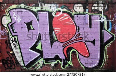 LONDON - APRIL 11, 2015. Street art on an old brick wall at Shoreditch in the Borough of Tower Hamlets, an area renown for its public painting in east London, UK. - stock photo