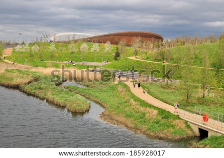 LONDON - APRIL 5. The new Queen Elizabeth Olympic Park on April 5, 2014, the opening day of the landscaped public area with the VeloPark cycling arena and other attractions, in Stratford, London, UK. - stock photo
