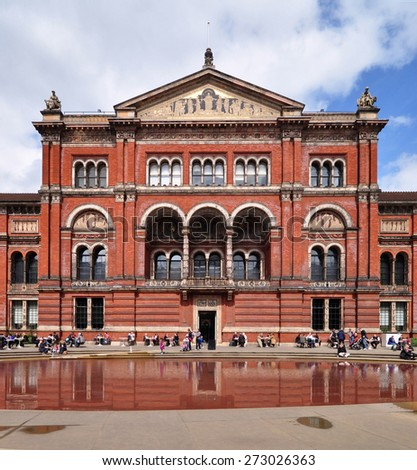 LONDON - APRIL 25, 2015. The north wing and garden pool of the Victoria & Albert Museum. The 1852 building houses the world's largest collection of decorative arts and design, located in London, UK. - stock photo