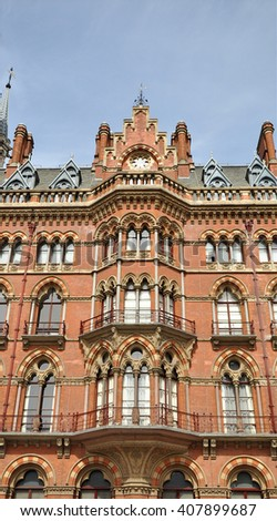 LONDON APRIL 10. 2016. The restored 1868 St Pancras International railway station and hotel, designed by Sir George Gilbert Scott, now the terminus for Eurostar services to Europe, in London, UK - stock photo