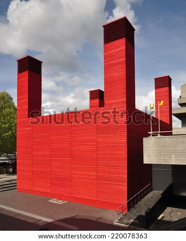 LONDON - APRIL 26. 'The Shed' is the National Theatre's temporary red timber venue that celebrates adventurous, ambitious and unexpected performances,  April 26, 2014 at the South Bank, London, UK. - stock photo