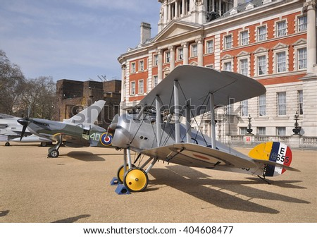 LONDON - APRIL 1, 2016. The Sopwith Snipe, a museum example of a 1917 vintage British single seater biplane briefly on public display by the Old Admiralty Building, Horse Guard's Parade, London, UK. - stock photo