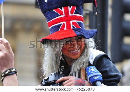 LONDON - APRIL 29 - Unidentified members of the public celebrate the Royal Wedding of Prince William and Kate Middleton on April 29, 2011 at Westminster Abbey, in London, England. - stock photo