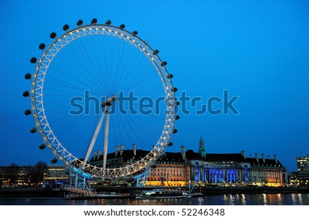 LONDON - APRIL 11: View of The London Eye on April 11, 2010 in London, England. At a height of 135m, it is the tallest Ferris wheel in Europe. - stock photo