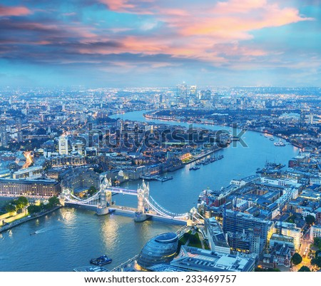 London at night. Aerial view of Tower Bridge area and city lights. - stock photo