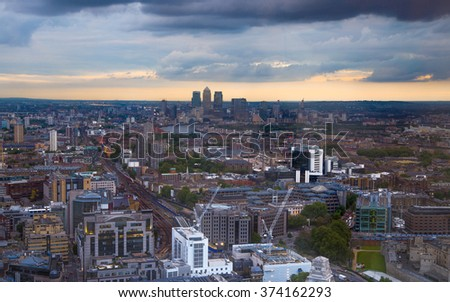 London at sunset, aerial view includes famous buildings, streets and Canary Wharf aria at distance  - stock photo