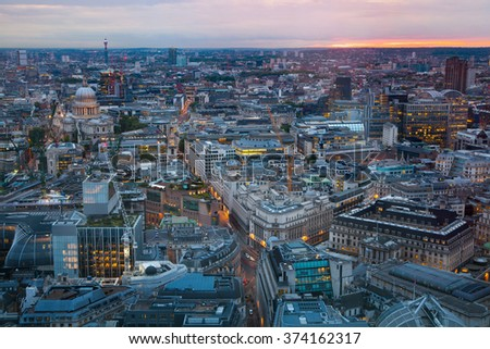 London at sunset, aerial view includes famous buildings, streets and st. Paul's cathedral at the distance - stock photo