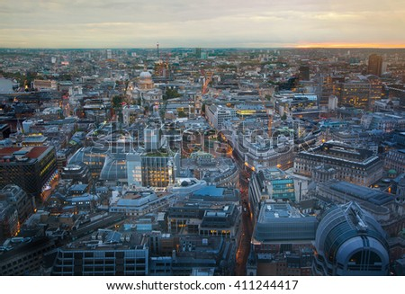 London at sunset. City of London, office buildings and streets lit up with first night lights - stock photo