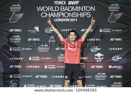 LONDON AUG 14: China's Lin Dan on the podium after defeating Malaysia's Lee Chong Wei in the men's singles final match of the World Badminton Championships at Wembley Arena in London, Aug 14, 2011. - stock photo