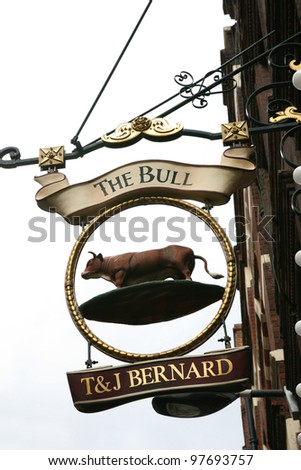 LONDON - AUG 23: English pub sign, Public house, known as pub, is focal point of the community, on Aug 23, 2010, London, UK. Pub business, now about 53,500 pubs in UK, has been declining every year - stock photo