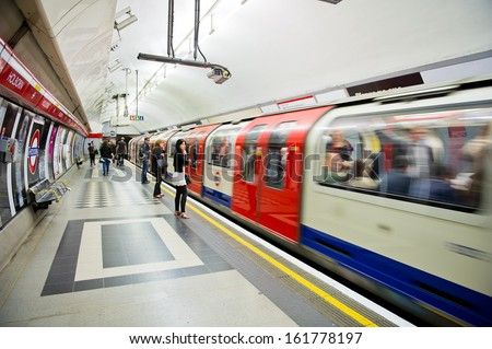 LONDON - AUG 6: Inside view of London underground on Aug. 6, 2012 in London, UK. London's system is the oldest underground railway in the world, dating back to 1863. - stock photo