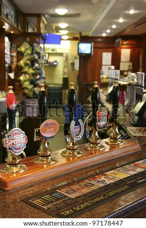 LONDON - AUG 26: Interior of pub, for drinking and socializing, focal point of the community, on Aug 26, 2010, London, UK. Pub business, now about 53,500 pubs in the UK, has been declining every year - stock photo