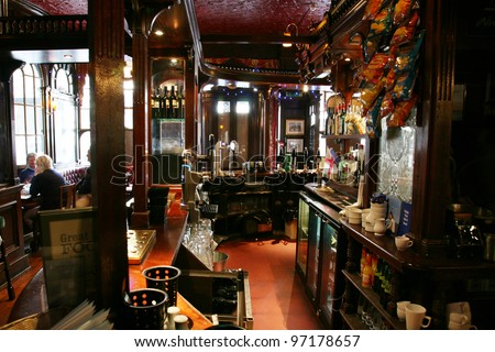 LONDON - AUG 30: Interior of pub, for drinking and socializing, focal point of the community, on Aug 30, 2010, London, UK. Pub business, now about 53,500 pubs in the UK, has been declining every year - stock photo