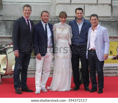 LONDON - AUG 7, 2015:  (L-R) Lionel Wigram, Guy Ritchie, Jacqui Ainsley, Henry Cavill and Josh Berger attend The Man from U.N.C.L.E. - UK film premiere at Somerset House on Aug 7, 2015 in London - stock photo