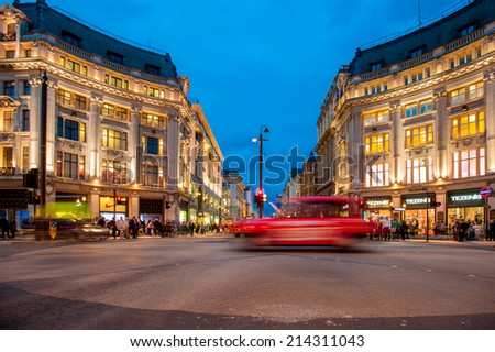 LONDON, AUG 29: People and traffic cross Oxford Circus, the busy intersection of Oxford Street and Regent Street in the West End of London on August 29, 2014. - stock photo