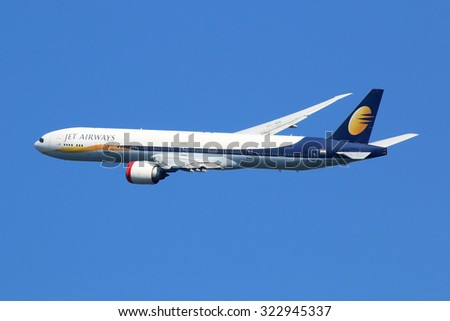 LONDON - AUGUST 28: A Jet Airways Boeing 777 taking off on August 28, 2015 in London. Jet Airways is the largest private carrier airline in India based in Mumbai. - stock photo