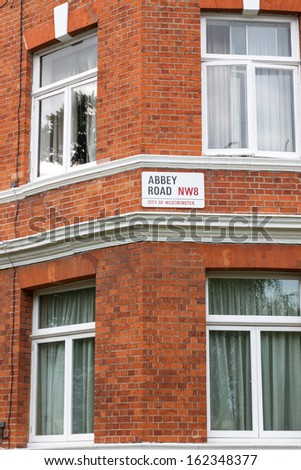 LONDON - AUGUST 6: Abbey Road sign at the recording studios on August 6, 2013. Abbey Road became famous thanks to the Beatles album cover in 1969. - stock photo