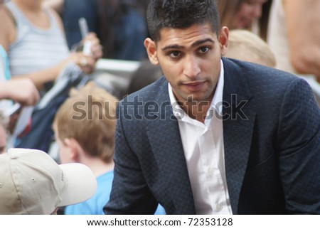 LONDON - AUGUST 9: Amir Khan greets fans as he arrives at the UK Premiere of 'The Expendables' in Leicester Square on August 9, 2010 in London - stock photo