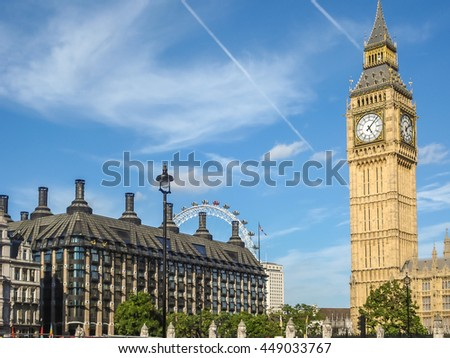 London - August 21, 2011: Big Ban Elizabeth tower clock face, Palace of Westminster and London Eye in background, London, UK - stock photo