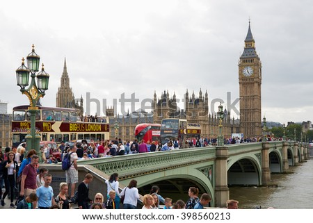 LONDON - AUGUST 4: Big Ben and crowd of tourists and people in a summer day on August 5, 2015 in London, UK. London is one of the most visited cities in the world. - stock photo