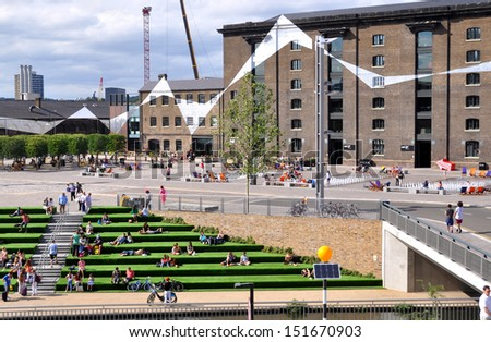 LONDON - AUGUST 4. Granary Square is a new regeneration development, terraced down to the Regent's Canal with graphics coordinating the surrounding historic buildings; August 4, 2013 in London, UK. - stock photo