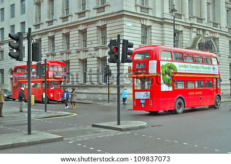 LONDON - AUGUST 10: Heritage Routemaster Bus operating in London on August 10, 2012 in London, UK. The open platform facilitated speedy boarding under the supervision of a conductor. - stock photo