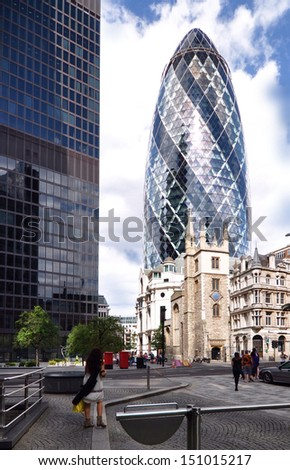 LONDON - AUGUST 10. Informally known as The Gherkin, 30 St Mary Axe is a 41 floor, 180 metre high building designed by Foster and Partners; August 10, 2013 in the financial district of London, UK.  - stock photo