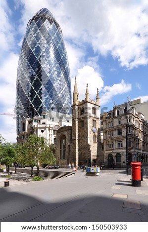 LONDON - AUGUST 10. Known informally as The Gherkin, 30 St Mary Axe is a 41 floor, 180 metre (591feet) building designed by Foster and Partners; August 10, 2013, in the Financial District, London, UK. - stock photo