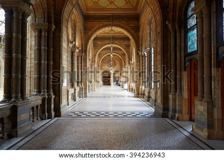 LONDON - AUGUST 7: Natural History Museum ancient architecture of empty corridor interior on August 7, 2015 in London, UK. The museum hosts a range of specimens from segments of natural history. - stock photo
