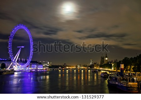LONDON - AUGUST 3: Night shot of the London Eye, Big Ben and Victoria Embankment, August 3, 2012. It's the iconic london landscape and the main tourist attractions. - stock photo