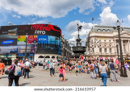 LONDON-AUGUST 4: People in Piccadilly Circus on August 24,2014 in London.A famous public space in London's West End, it was built in 1819 to join Regent Street with the shopping street of Picadilly  - stock photo