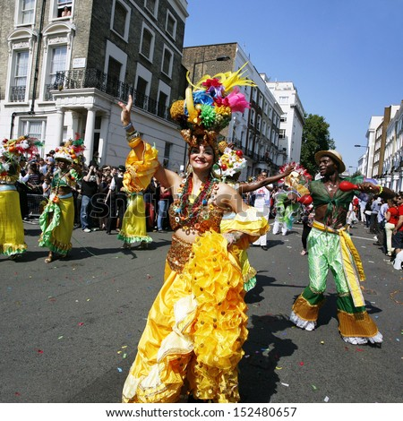 LONDON - AUGUST 26: Performers take part in the second day of Notting Hill Carnival, largest in Europe, on August 26, 2013 in London, UK. Carnival takes place over two days in every August.   - stock photo