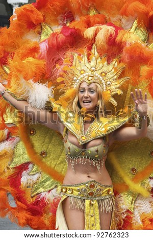 LONDON - AUGUST 28: Performers take part in the second day of Notting Hill Carnival, largest in Europe, on August 28, 2006 in London, UK. Carnival takes place over two days in every August. - stock photo