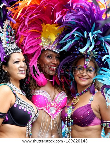 LONDON - AUGUST 27: Performers take part in the third day of Notting Hill Carnival, the largest in Europe, on August 27, 2012 in London, UK. Carnival takes place over three days in every August. - stock photo