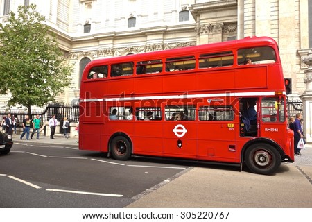 LONDON - AUGUST 10: Routemaster Bus operating in London on August 10, 2015 in London, UK. The open platform facilitated speedy boarding under the supervision of a conductor.  - stock photo