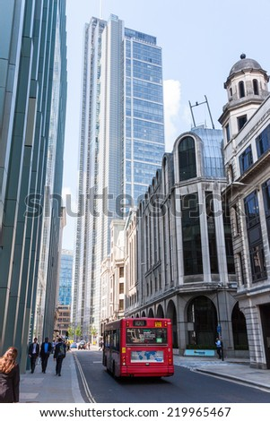 LONDON -AUGUST 6:Typical double decker bus in The City of London on August 6, 2014 in London.  The City of London is the financial district of London and vies to be the financial capital of the world. - stock photo