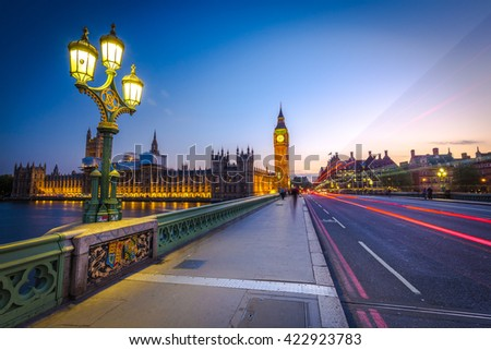 London Big Ben and traffic on Westminster Bridge in United KIngdom. - stock photo