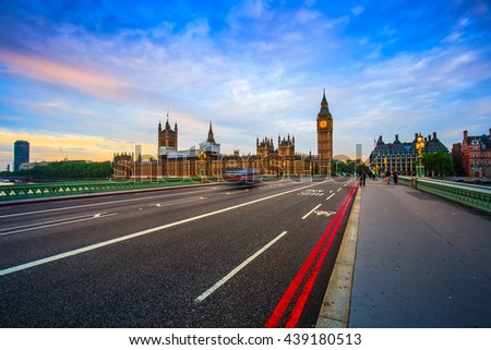 London Big Ben and traffic on Westminster Bridge in United KIngdom at sunrise in Uk. - stock photo