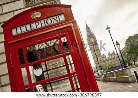 London - Big Ben tower and a red phone booth - stock photo