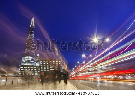 London Bridge at night with traffic peak time. Night scene with the Shard in the background. - stock photo