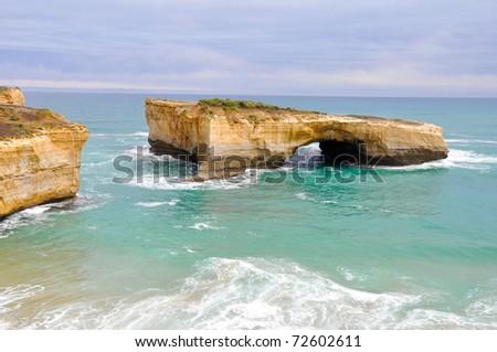 London bridge, famous rock formations  in Great Ocean Road, Australia. - stock photo