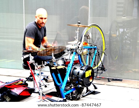 """LONDON - CIRCA SEPTEMBER 2011 : Unidentified drummer who calls himself """"The Puncture Kit"""", he dismantles his bicycle and then turns it into a drum kit in Oxford Street, London circa September 2011. - stock photo"""