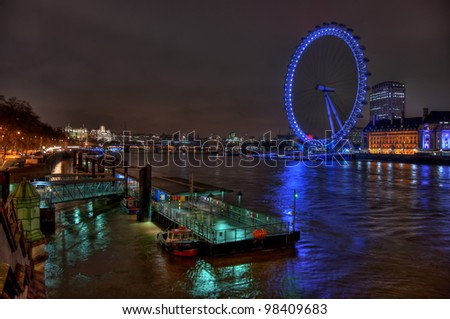 LONDON - CIRCA 2010: View from Westminster Bridge with illuminated London Eye circa 2010 in London. London Eye, situated on the banks of the river Thames, is the tallest Ferris wheel in Europe. - stock photo