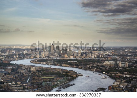 London city aerial view over skyline with dramatic sky - stock photo