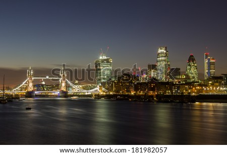 London City and Tower Bridge at Night from across the river thames - stock photo
