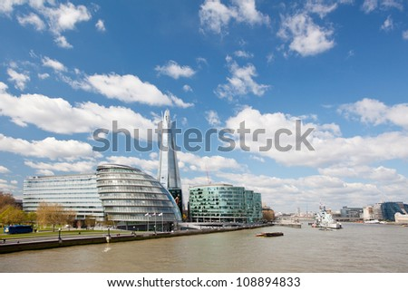 London City Hall Skylines along River Thames against blue sky, England UK - stock photo