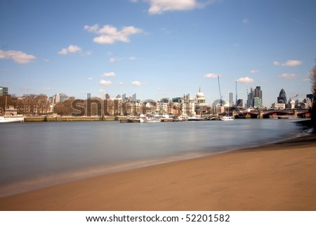 london city skyline at midday in spring with lots of cranes and construction - stock photo