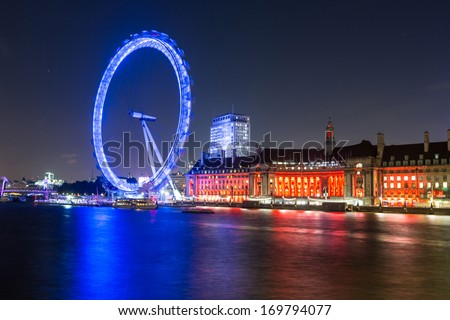 London Cityscape with Millennium Wheel at Night - stock photo